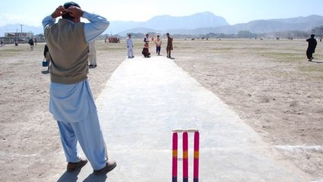 People playing cricket in Kabul, Afghanistan
