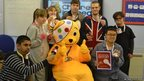 School reporters pose with Pudsey