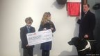 Students present David Blunkett with a cheque
