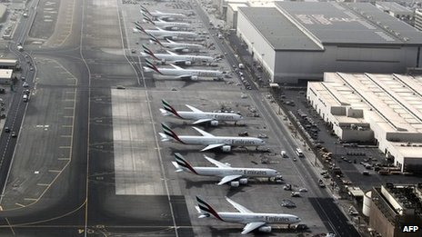 Planes parked on tarmac at Dubai airport