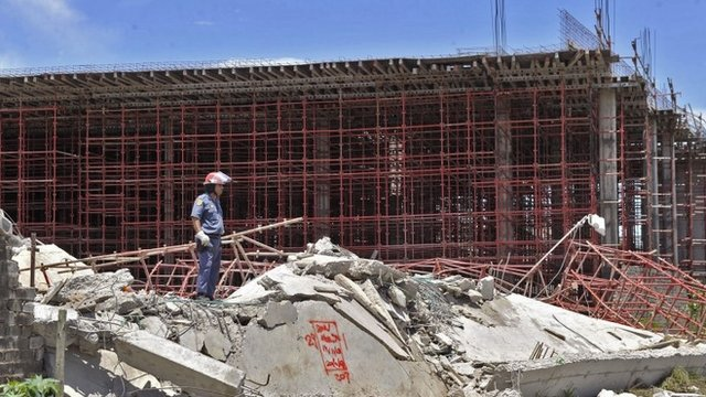 Police officer at site of mall collapse