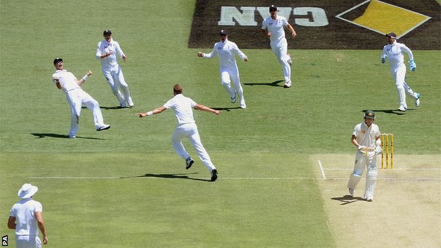England celebrate after dismissing Michael Clarke