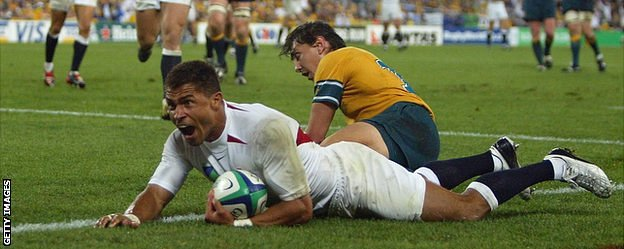 Jason Robinson celebrates as he dives over the line to score England's try