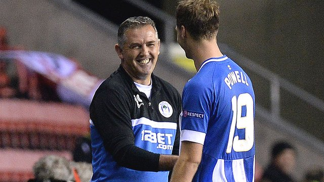 Wigan manager Owen Coyle shakes hands with Nick Powell
