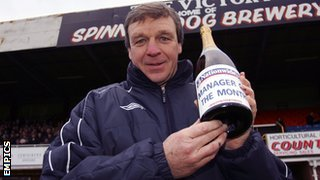 Graham Turner, in his days as Hereford United manager, holds aloft one of his many Manager of the Month awards
