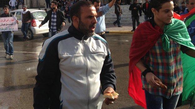 Protesters in Tripoli clutching baryooshes, Libya, November 2013