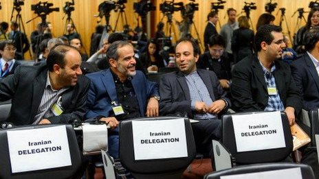 Iranian journalists wait for the Iranian negotiating team to arrive for nuclear talks in Geneva on November 9.