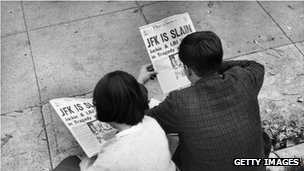 People read newspaper after Kennedy's death