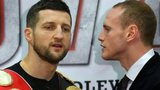 Carl Froch (left) and George Groves go head to head during a press conference at the Manchester Conference Centre