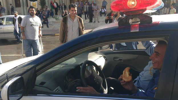 A policeman in a car with a baryoosh in Tripoli, Libya - November 2013
