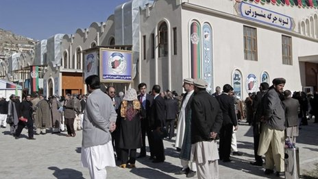 Members of Afghan Loya Jirga outside venue in Kabul