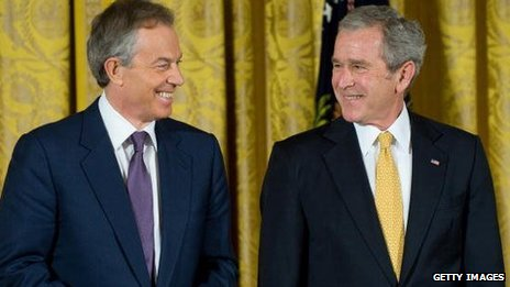 Former Prime Minister Tony Blair and US President George W Bush smile while at the White House in 2009.