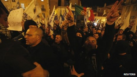 Demonstrators try to approach the Portuguese parliament in Lisbon on 21 November