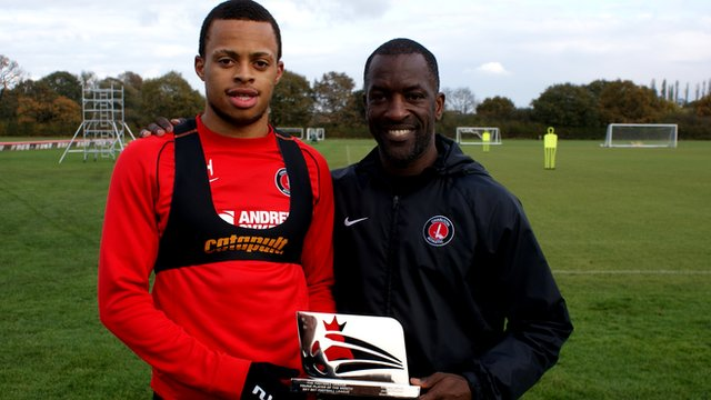 Charlton midfielder Jordan Cousins (l) and manager Chris Powell