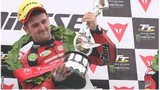 Michael Dunlop celebrates victory at this year's Isle of Man TT