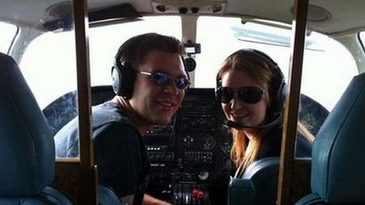 Paul Tribble and Elizabeth Geeves inside a cockpit
