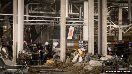 Shelves can been seen inside the store in this photograph taken in the immediate hours after the roof collapsed in Riga