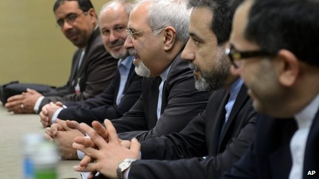 "Iranian Foreign Minister Mohammad Javad Zarif, center, attends talks on Iran""s nuclear program in Geneva on Friday Nov. 22, 2013"