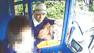 Anxiang Du speaks to a bus driver