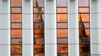 The Fishermen's Bastion is reflected in the windows of the Hilton hotel in Budapest