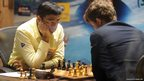 India's Viswanathan Anand (left) and Norway's Magnus Carlsen compete in their 10th championship chess match