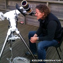 Gary Fildes looking through a telescope