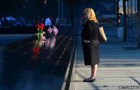 Woman stands at 9/11 memorial