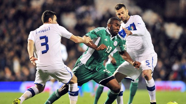 Dike (centre) in action against Italy