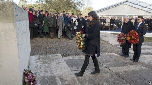 Tatiana Schlossberg lays a wreath at the memorial