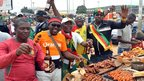 Cameroonian fans drinking beer and eating meat as they celebrate their victory over Tunisia in Yaounde, Cameroon - Sunday 17 November 2013