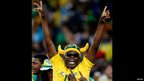 A celebrating Bafana Bafana fan in a horn hat at Soccer City in Johannesburg, South Africa - Tuesday 19 November 2013