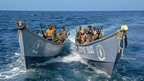 Somali coast guards in boats off Bossasso, Somalia - Tuesday 19 November 2013