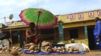 A vendor under an umbrella at Gorongosa market, Mozambique - Tuesday 19 November 2013