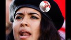 A Tunisian woman wearing a black beret and a badge of Saddam Hussein - Friday 15 November 2013