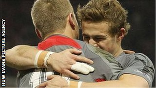 Owen Williams is congratulated by debutant Hallam Amos after scoring Wales's first try against Tonga.