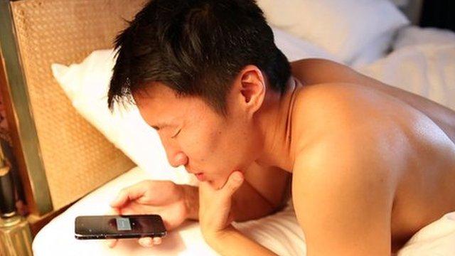 Hunter Soik recounts his dream into a smart phone