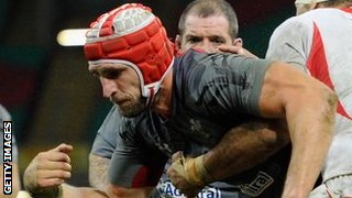 Luke Charteris loses the ball as he crosses Tonga's line
