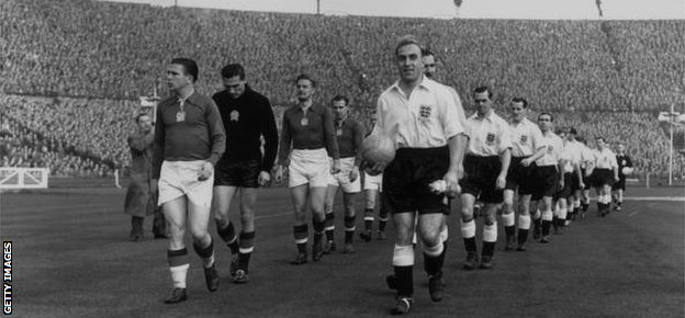 The English and Hungarian captains, Ferenc Puskas (left) and Billy Wright lead out their teams at Wembley in November 1953