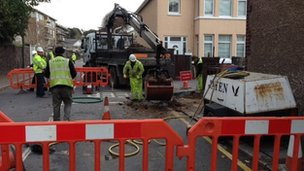 Workers at hole in Trinity Road
