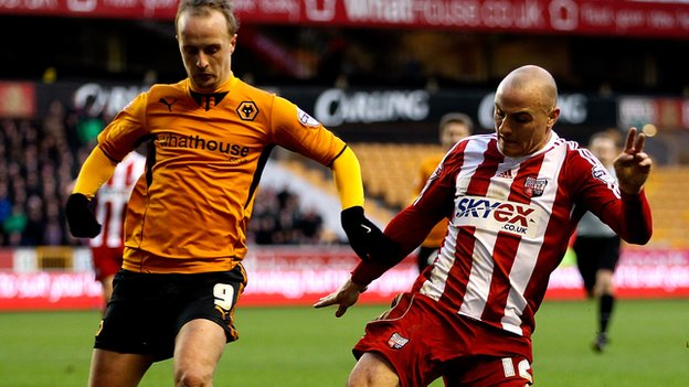 Wolves top scorer Leigh Griffiths contests a loose ball at Molineux with Brentford midfielder Alan McCormack