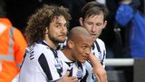 Yoan Gouffran (centre) is congratulated by team-mates Fabricio Coloccini (left) and Mike Williamson after his goal against Norwich