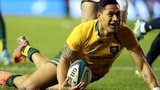 Israel Folau dives over to score a try for Australia