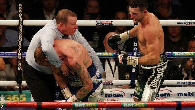 Referee Howard Foster stops Carl Froch (right) and George Groves in their WBA and IBF super- middleweight Title