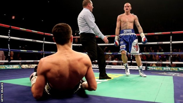 Carl Froch is knocked down to the canvas by George Groves