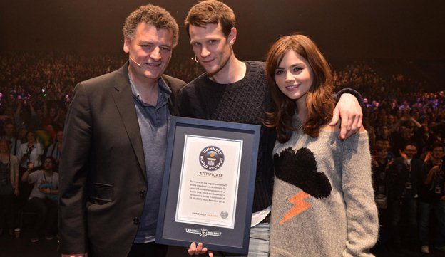 Steven Moffat, Matt Smith and Jenna Coleman accept the programme's World Record certificate