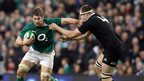 Sean O'Brien fends off a tackle from Luke Romano during New Zealand's win over Ireland in Dublin