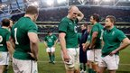Ireland players, including skipper Paul O'Connell and Brian O'Driscoll, show their dejection after a last-gasp defeat by New Zealand