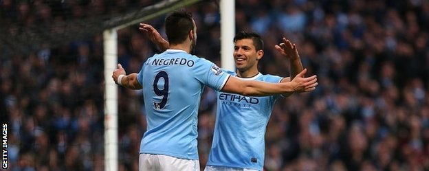 Alvaro Negredo and Sergio Aguero celebrate after Negredo scores City's fifth goal against Spurs