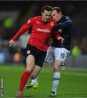 Wayne Rooney clashes with Jordan Mutch