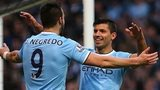 Alvaro Negredo and Sergio Aguero celebrate after Negredo scores City's fifth goal